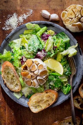 Garlic Lover's Roasted Garlic Caesar Salad, with roasted garlic in the dressing and a whole head of roasted garlic to go on each serving! The dressing is egg-free and it has capers in it!!   Healthy Seasonal Recipes   Katie Webster