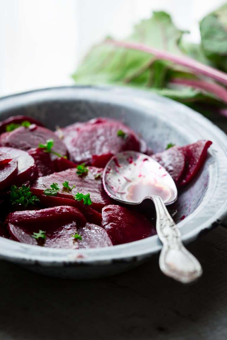 With just 10 minutes of prep and only 5 ingredients you can transform earthy beets into tangy tender slices of absolute goodness. These Simple Pickled Beets are a gluten free, paleo-friendly, vegetarian side dish that will make all of your Summer grilling dishes sing! | Healthy Seasonal Recipes | Katie Webster