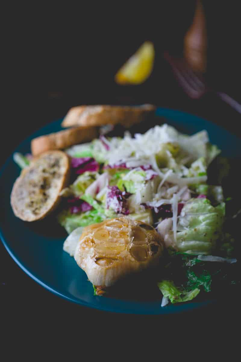 The Best Caesar Salad on HealthySeasonalRecipes with a whole head of roasted garlic per person