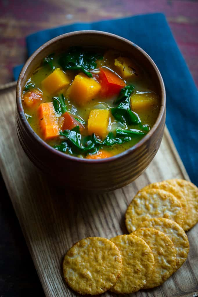 Vegan Vegetable Soup in bowl next to crackers
