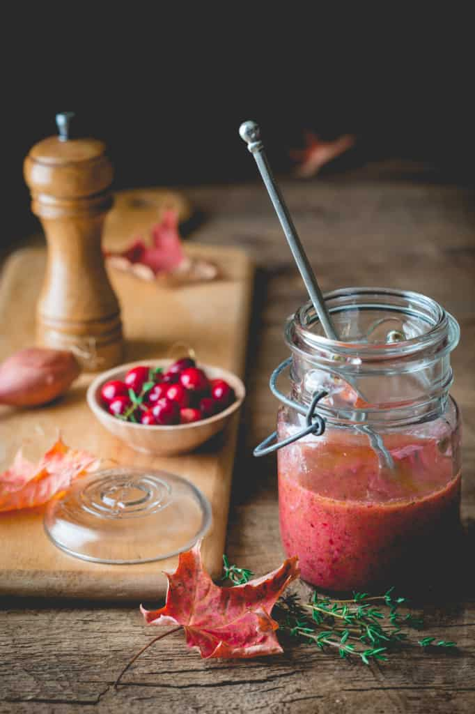 Cranberry Vinaigrette in jar next to serving board