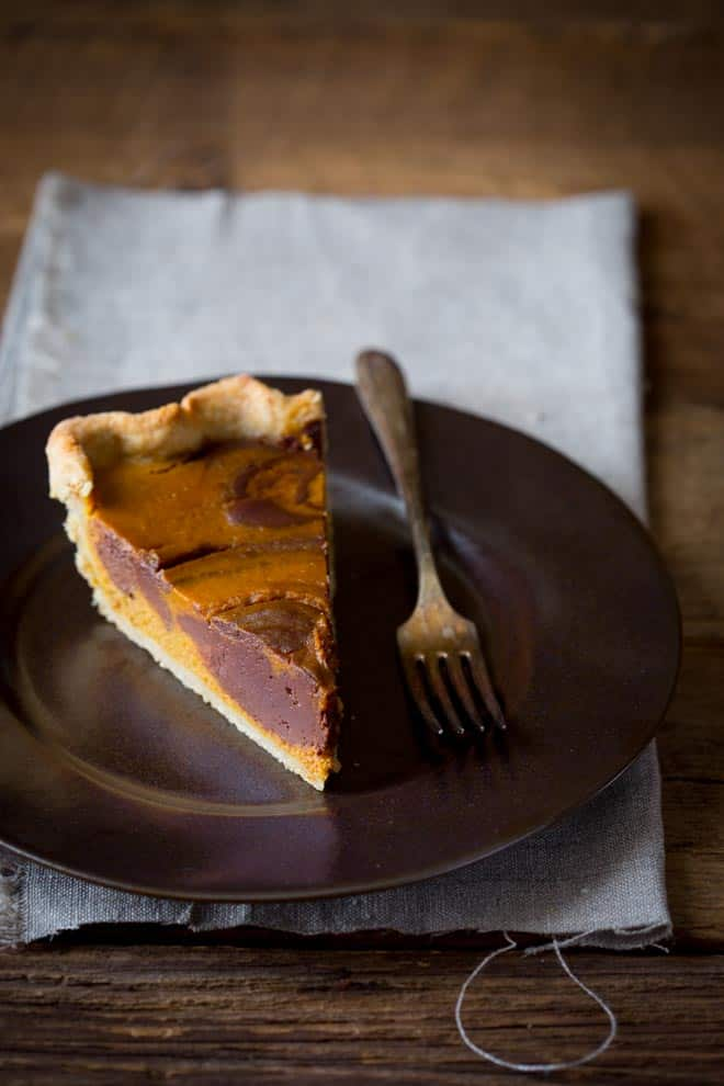Chocolate Swirl Pumpkin Pie, maple sweetened with a whole grain crust on healthyseasonalrecipes.com