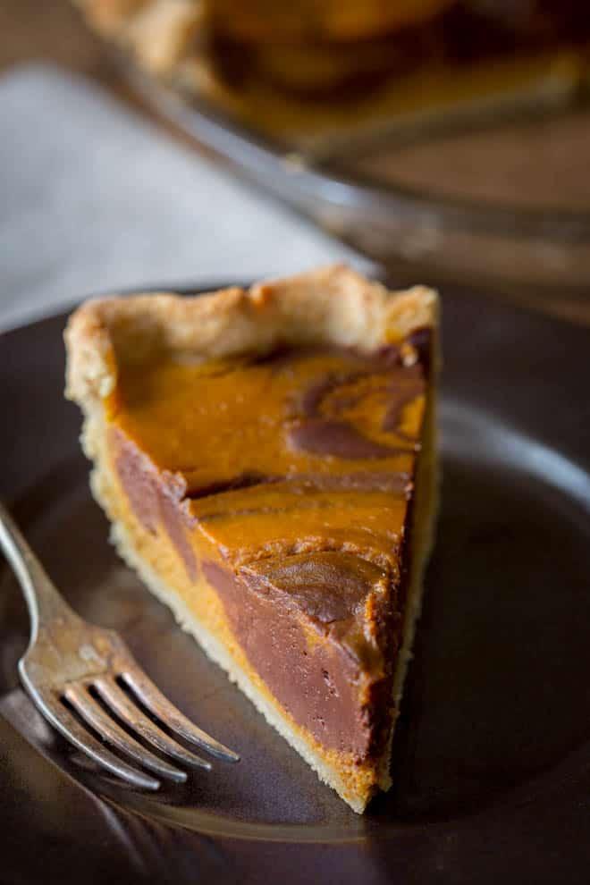 Chocolate Swirl Pumpkin Pie, maple sweetened with a whole grain crust on healthyseasonalrecipes.com