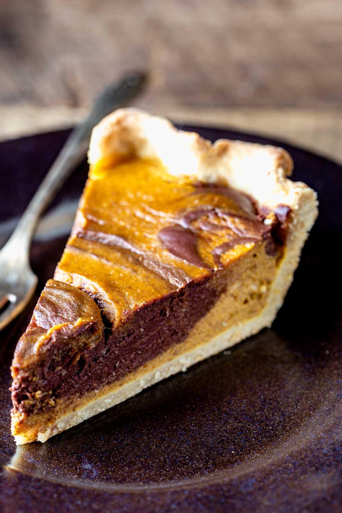 chocolate swirl pumpkin pie on a plate