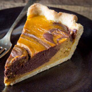 a slice of chocolate swirl pumpkin pie