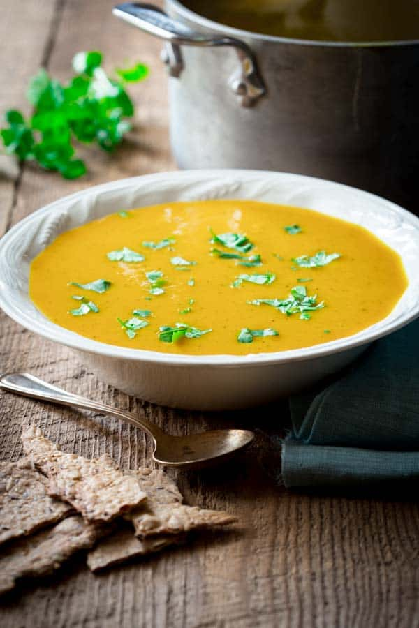 Clean Eating Curry Butternut Squash Soup with coconut milk. Only 180 creamy delicious calories per bowl. Gluten-free, paleo and vegan. Perfect cure for the overindulgences of the holiday season. This soup will set you right! on healthyseasonalrecipes.com