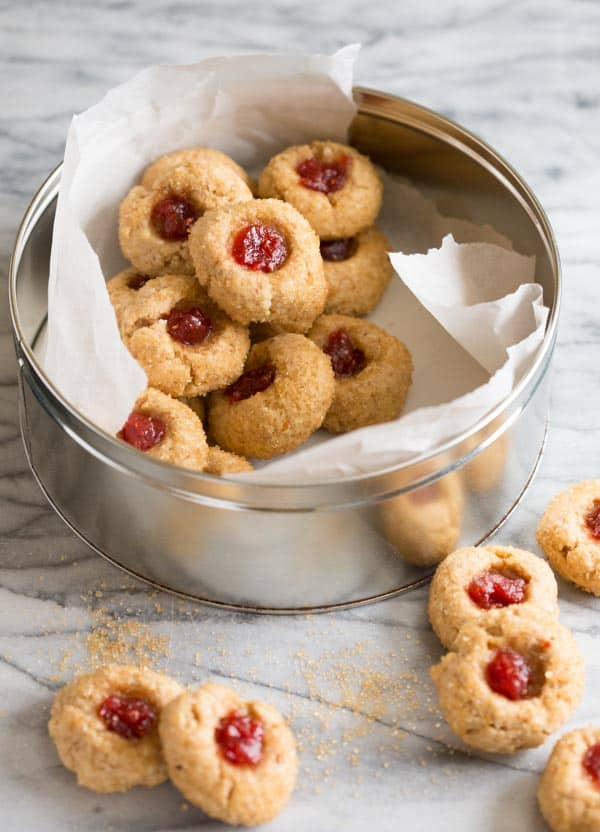 Healthy Jam Thumbprint Cookies | Raspberry Almond Linzer Thumbprints for Christmas cookie collection by Katie Webster on Healthy Seasonal Recipes