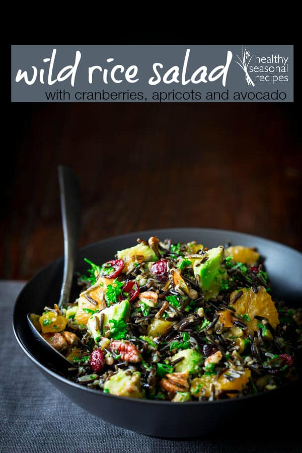 Wild Rice Salad recipe with tangerines, cranberries, dried apricots, pecans and avocado. Naturally gluten-free and vegan friendly. On Healthy Seasonal Recipes.