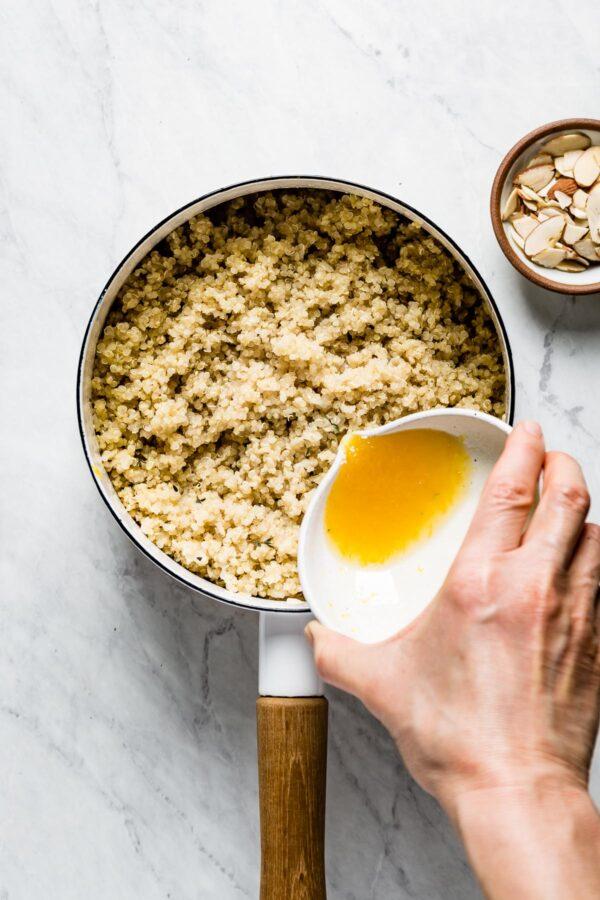 pouring lemon into quinoa