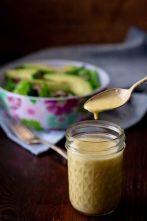 apple cider vinegar salad dressing in a jar with a spoon