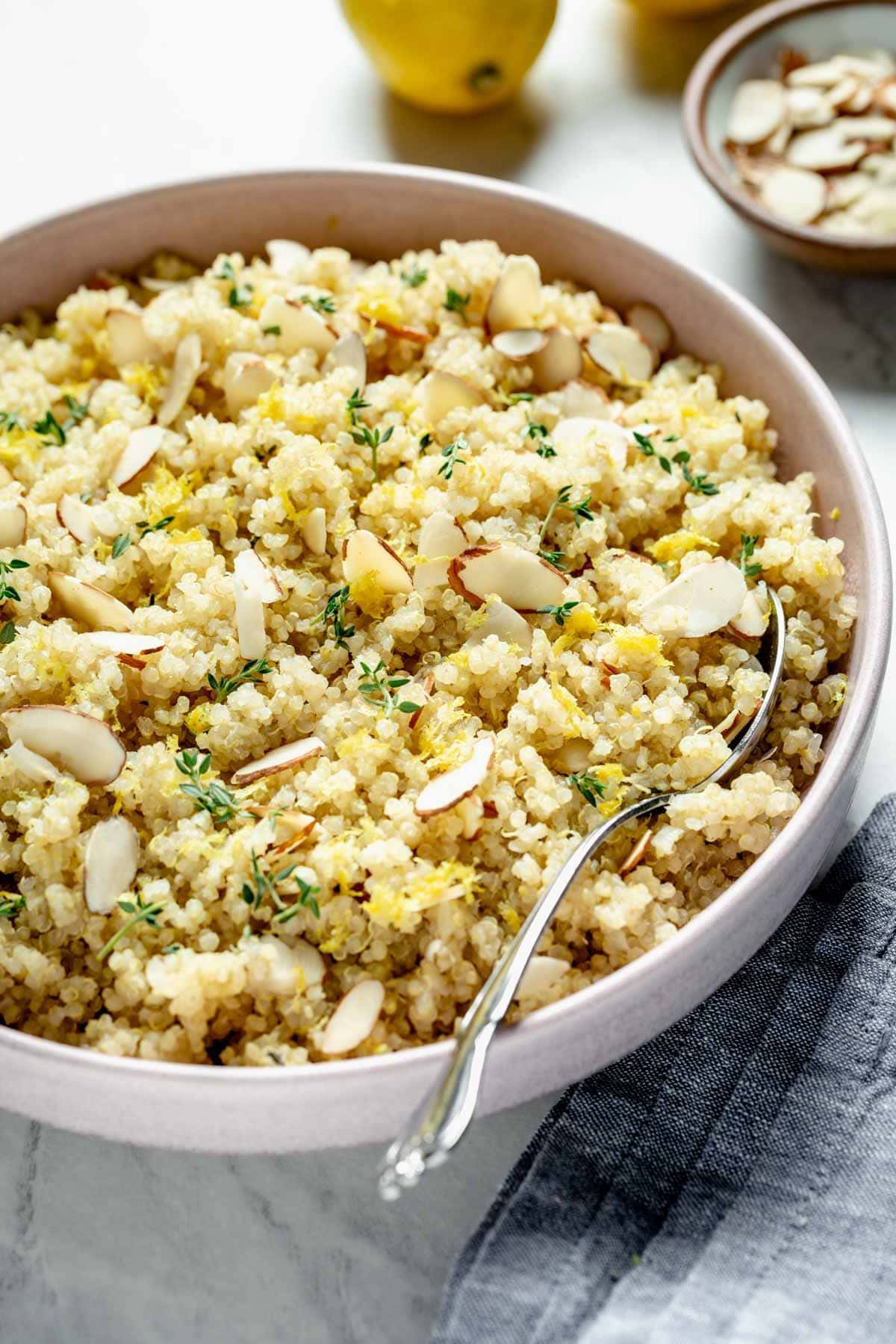 lemon quinoa with almonds and thyme from the side close up