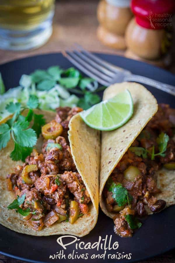 This picadillo recipe is so flavorful and juicy. I love the sweet raisins and briney olives in the rich meat sauce. Serve in tacos or wrapped in lettuce. Paleo and Gluten-free