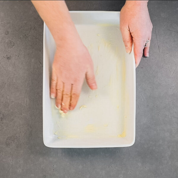 buttering the casserole dish