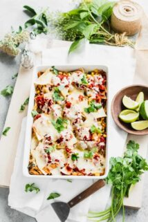 Mexican Chilaquiles Casserole with chicken and cheese overhead with a bowl of limes