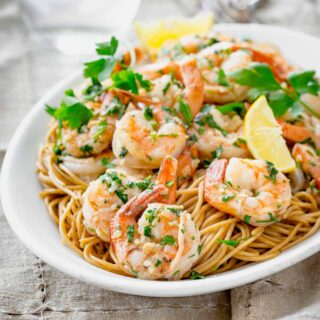 shrimp on a platter on pasta