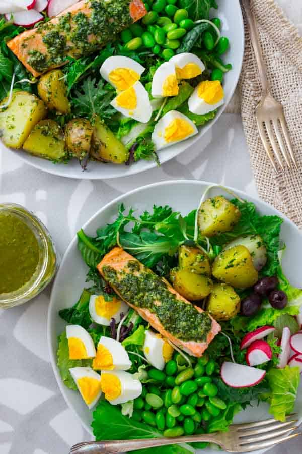 Pesto salmon and edamame salad nicoise with hard boiled eggs, olives, potatoes and radishes | Gluten-free and grain free