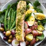 a close up overhead of salmon nicoise with pesto