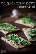 arugula and garlic pizza with balsamic reduction