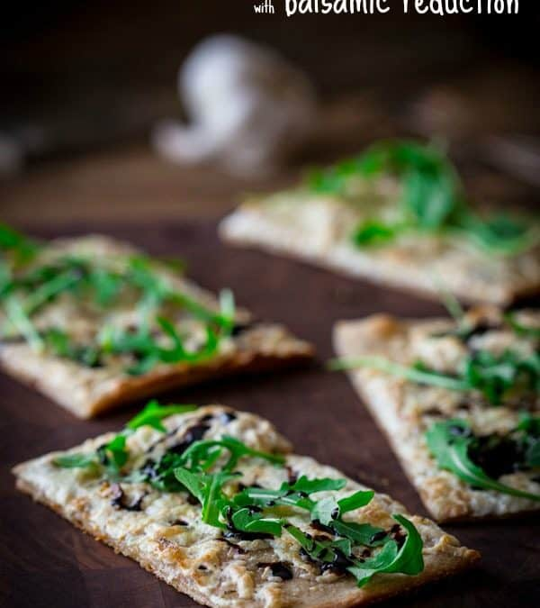 garlic and arugula pizza with balsamic reduction