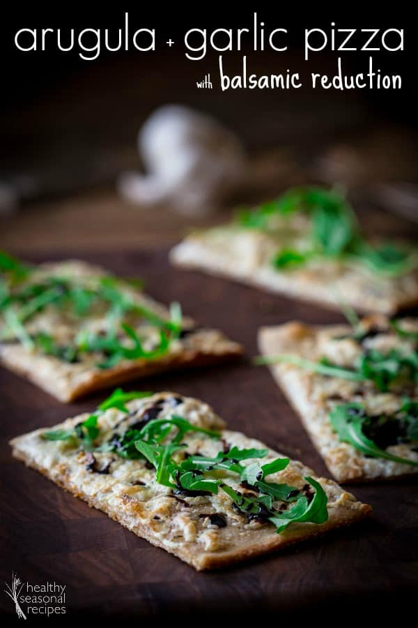 Thin-crust arugula pizza with garlic and balsamic reduction