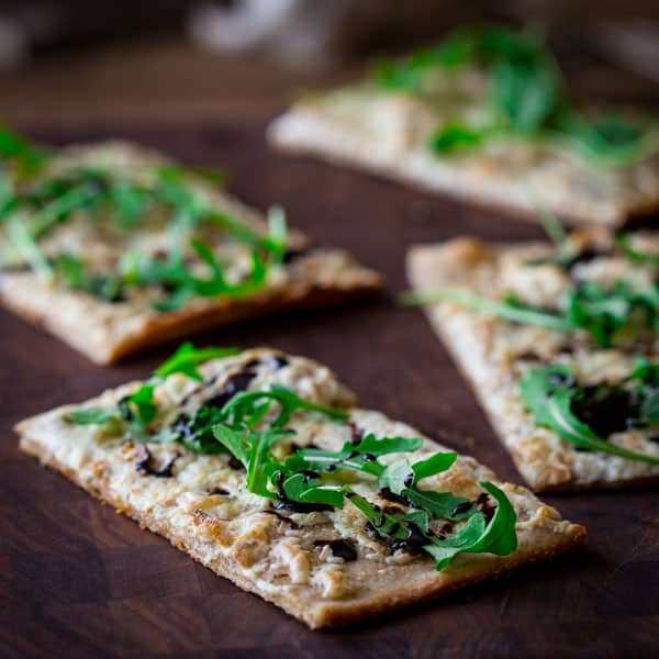 Balsamic reduction drizzled over white flatbread pizza