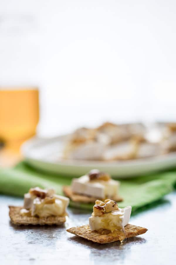 Brie Honey and Walnut Bites, Just 3 simple toppings on a Triscuit cracker for an easy, sweet and savory appetizer or snack.