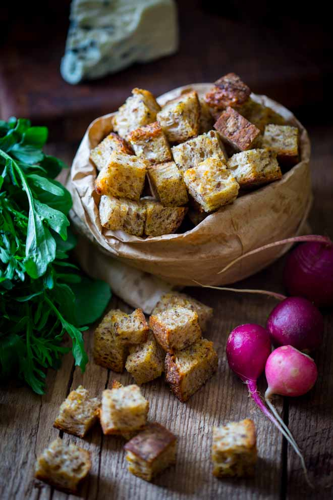 homemade croutons in brown paper bag