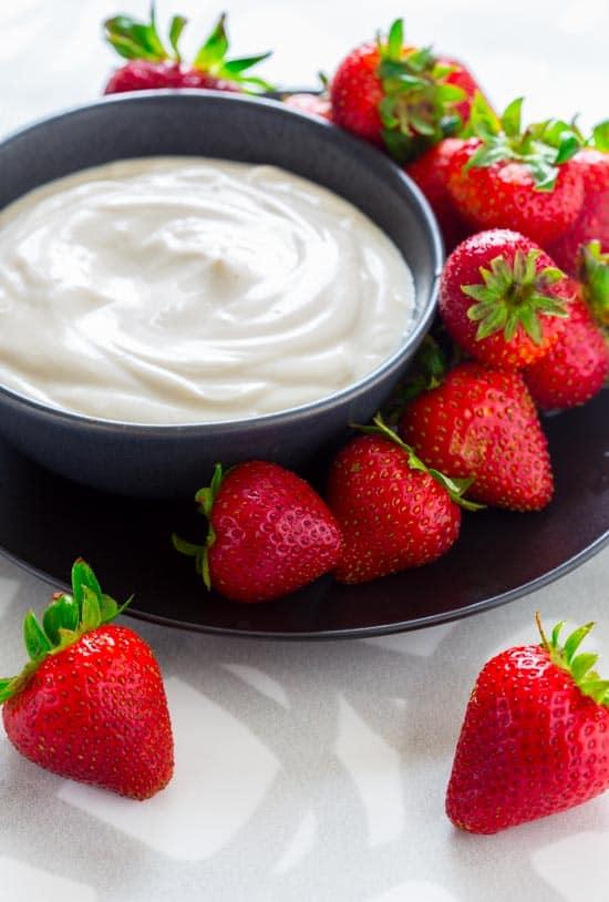 Maple Greek Yogurt Dip in a bowl with berries