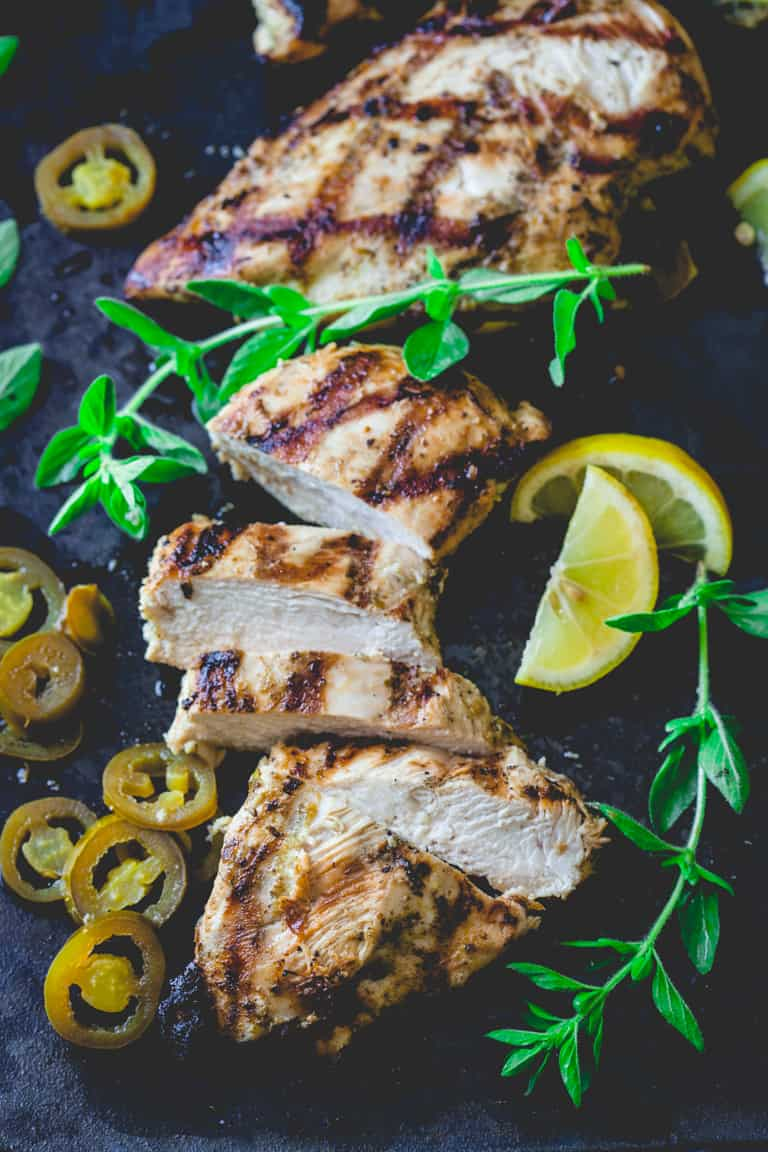 Juicy garlic lemon chicken marindae with oregano and pickled jalapenos on Healthy Seasonal Recipes. Naturally gluten-free. Works with chicken breast, chicken thighs and all different kind of meat too!