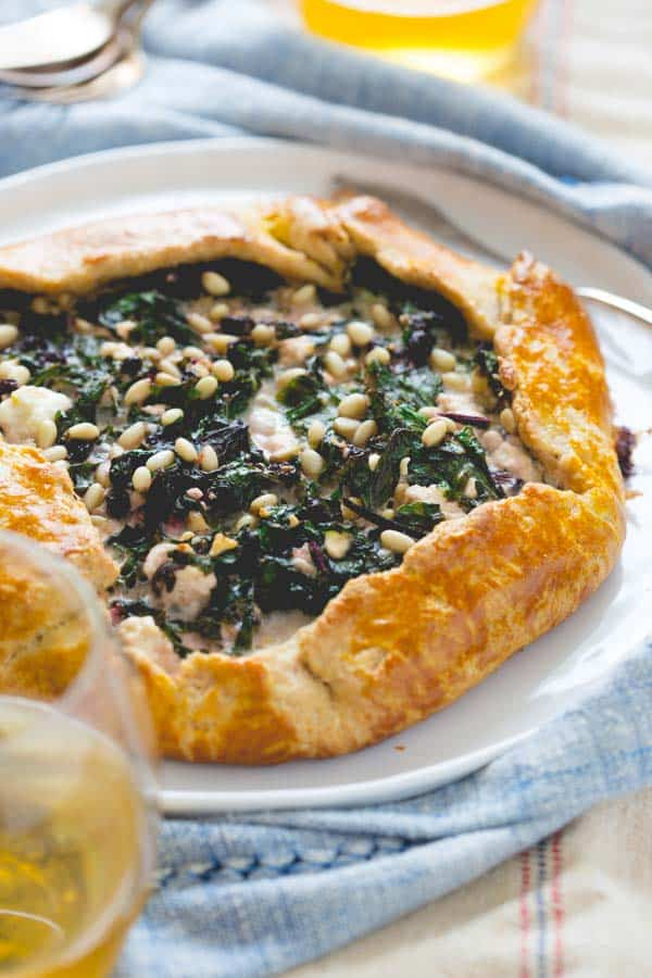 Kale, beet greens and feta inside whole-wheat buttermilk pastry in a savory free-form galette   vegetarian   HealthySeasonalRecipes.com
