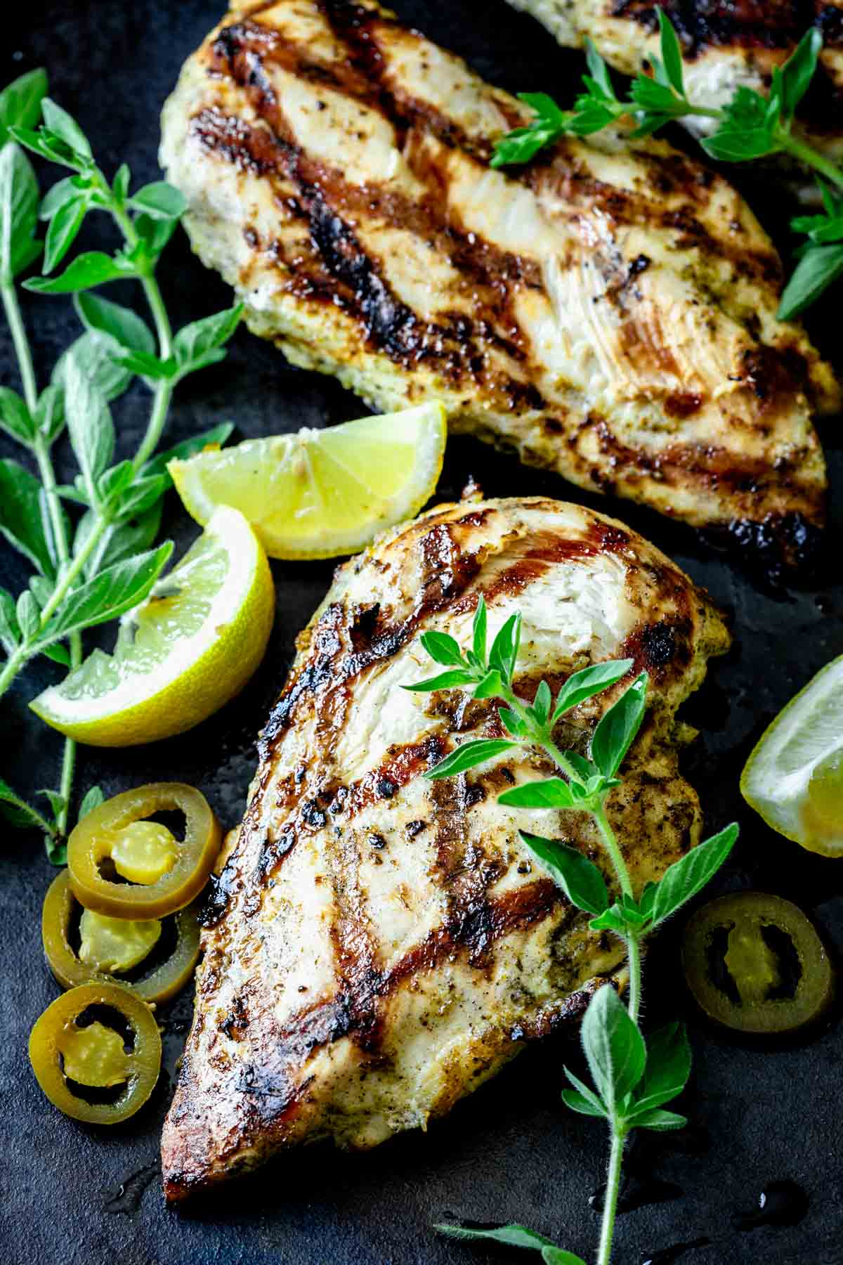 grilled chicken with oregano sprigs