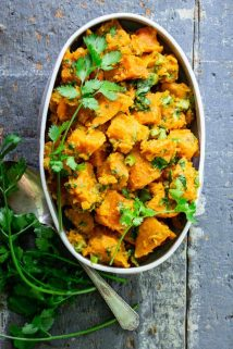 Paleo Sweet Potato Salad in a white dish on a blue surface