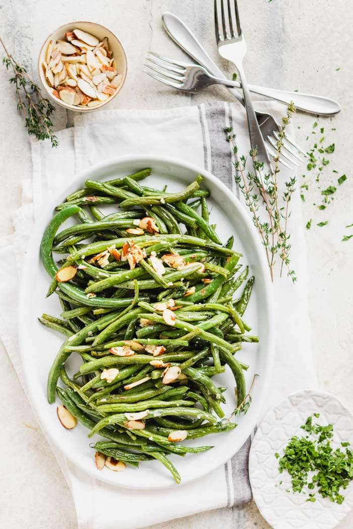 platter of green beans with thyme sprigs