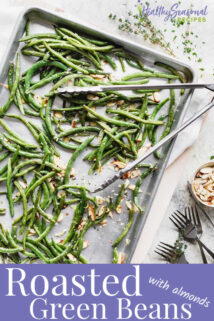 a pan of roasted green beans from overhead with a set of tongs on top