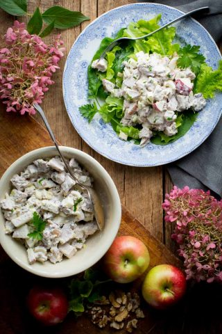Healthy Waldorf Chicken Salad, an easy gluten-free lunch that is high in protein but under 300 calories! It has celery, apples, walnuts and poached chicken breast in a creamy Greek yogurt dressing. #healthy #glutenfree #lunch #highprotein #chicken #chickensalad #apples #celery #walnuts #cleaneating #GreekYogurt #healthyseasonal