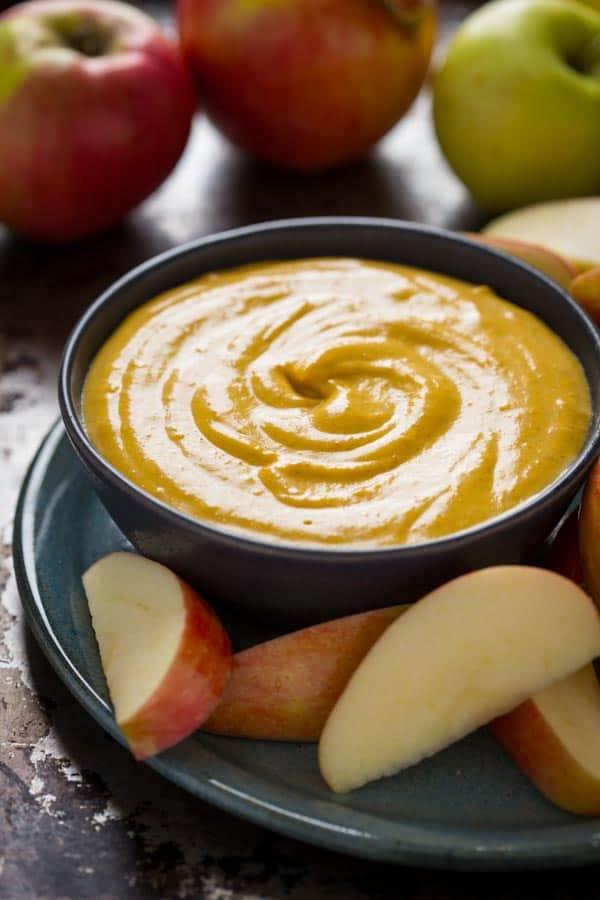 Maple Pumpkin Pie Dip in bowl with apple slices