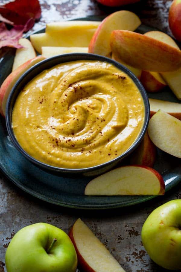 Maple Pumpkin Pie Dip on platter with apples