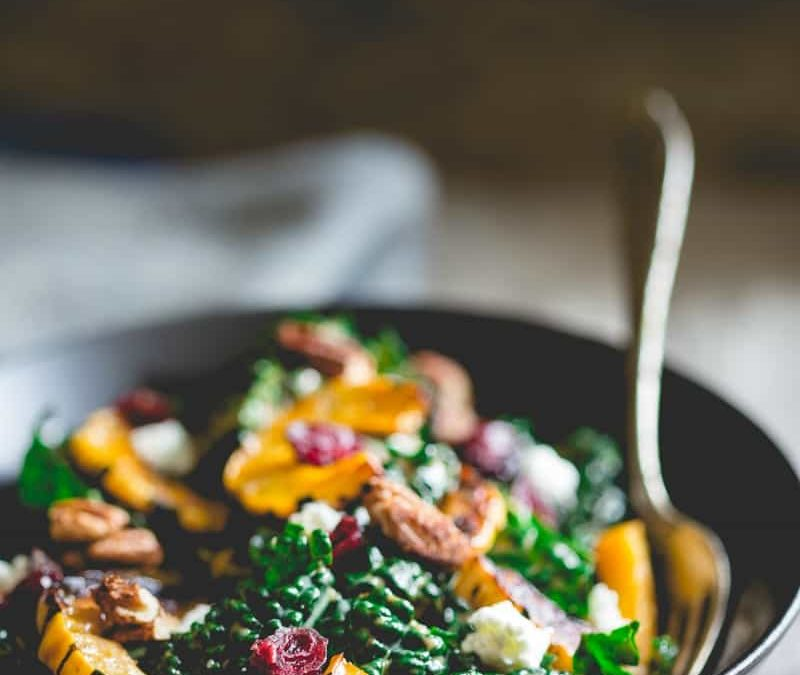 kale salad with roasted delicata squash, chevre, dried cranberries and spiced pecans