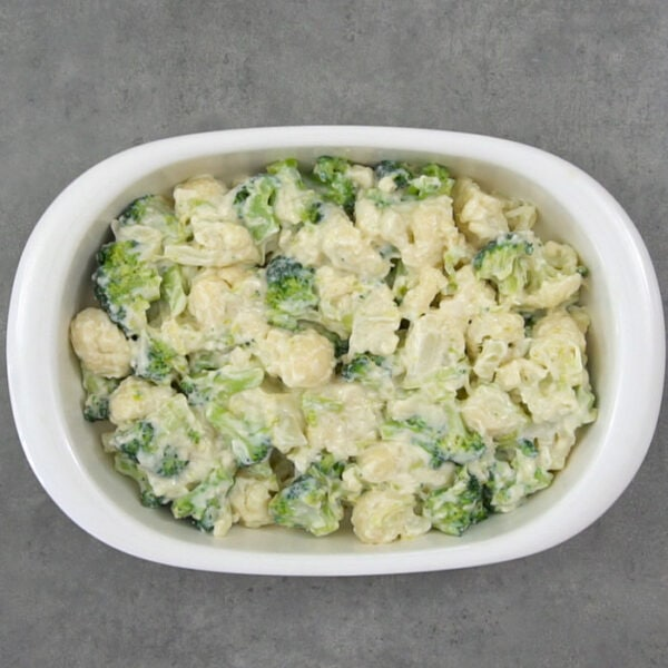 the broccoli and cauliflower with cheese sauce in the casserole dish