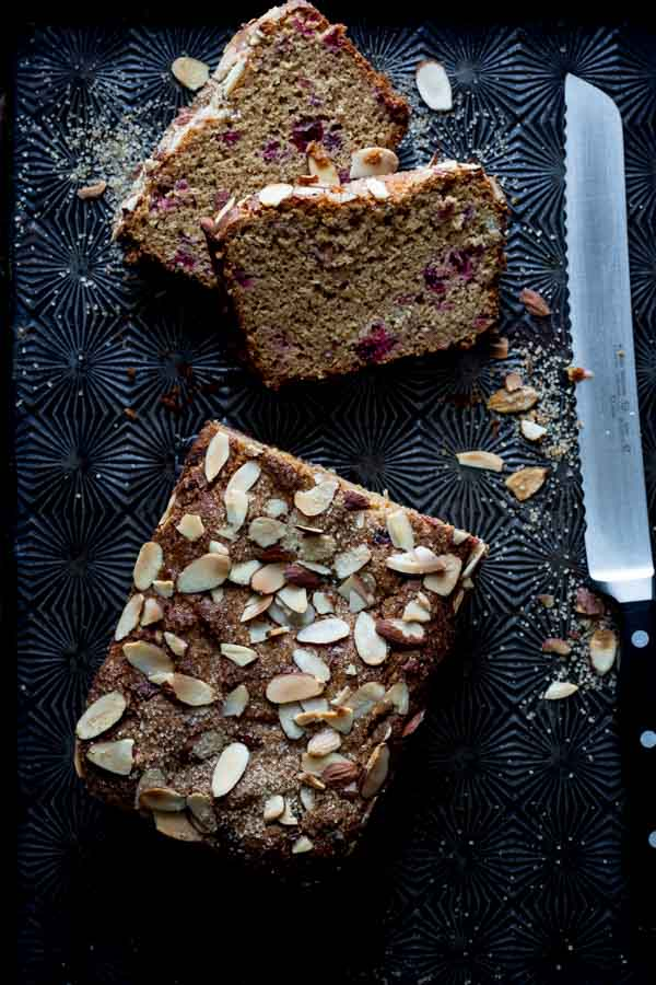 almond cranberry bread loaf sliced with knife