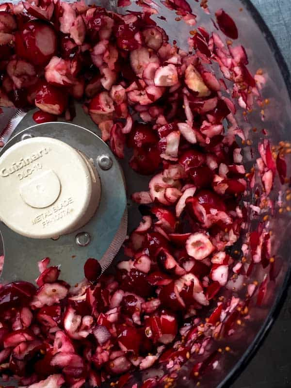 chop cranberries in food processor for Cranberry Almond Quick Bread on healthyseasonalrecipes.com