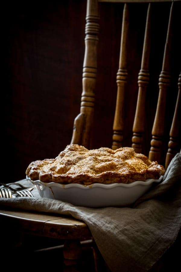 Deep Dish Double Crust Maple Apple Pie on a chair