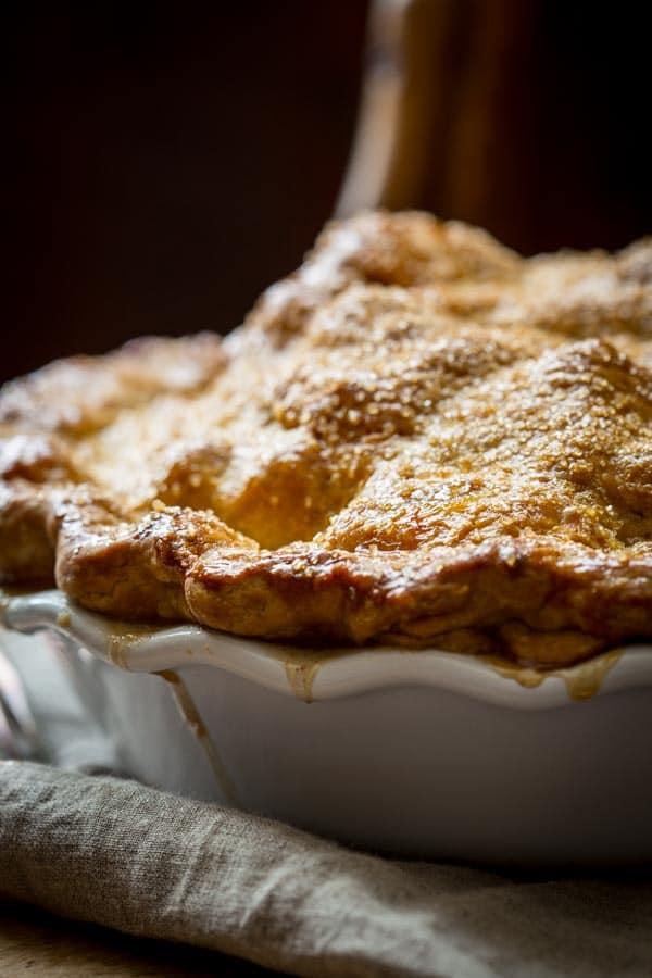 Deep Dish Double Crust Maple Apple Pie up close on towel