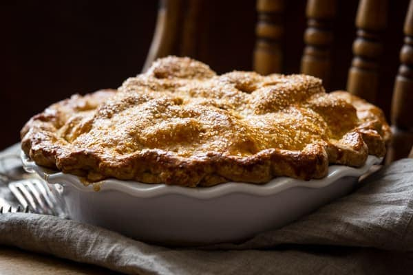 Fool proof recipe for Deep Dish Double Crust Apple Pie sweetened with Maple Syrup. With tips on how to get great whole-wheat crust and blue ribbon filling!