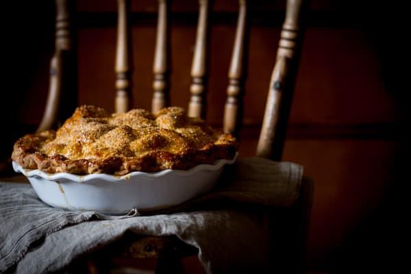 deep dish apple pie on a chair