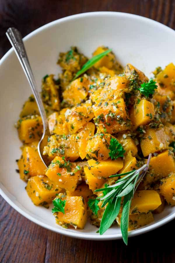 garlic and herb steamed butternut squash in a large bowl