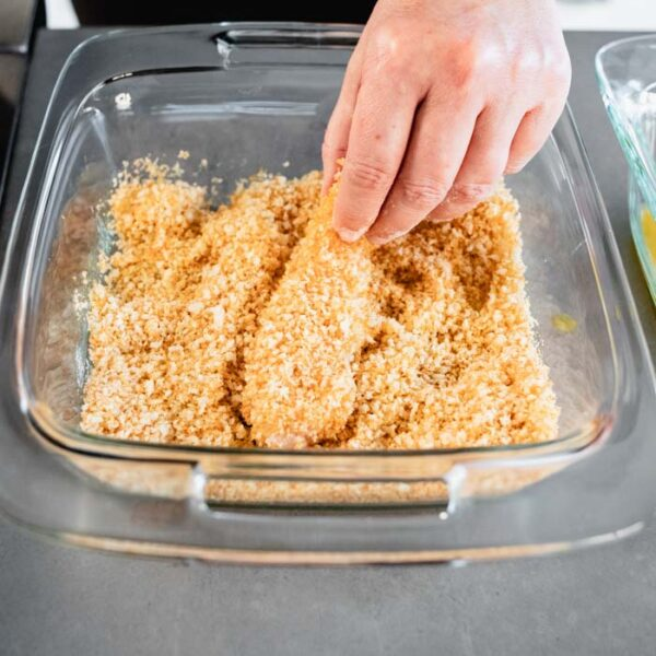 Press the chicken tender into the panko mixture to coat completely.