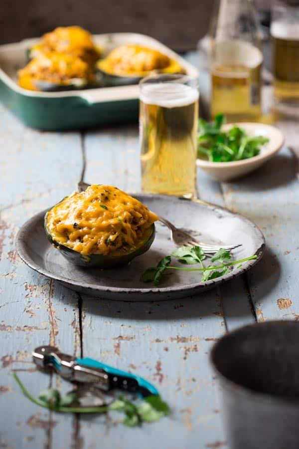 Cheesy Mexican Quinoa Stuffed Acorn Squash on a plate