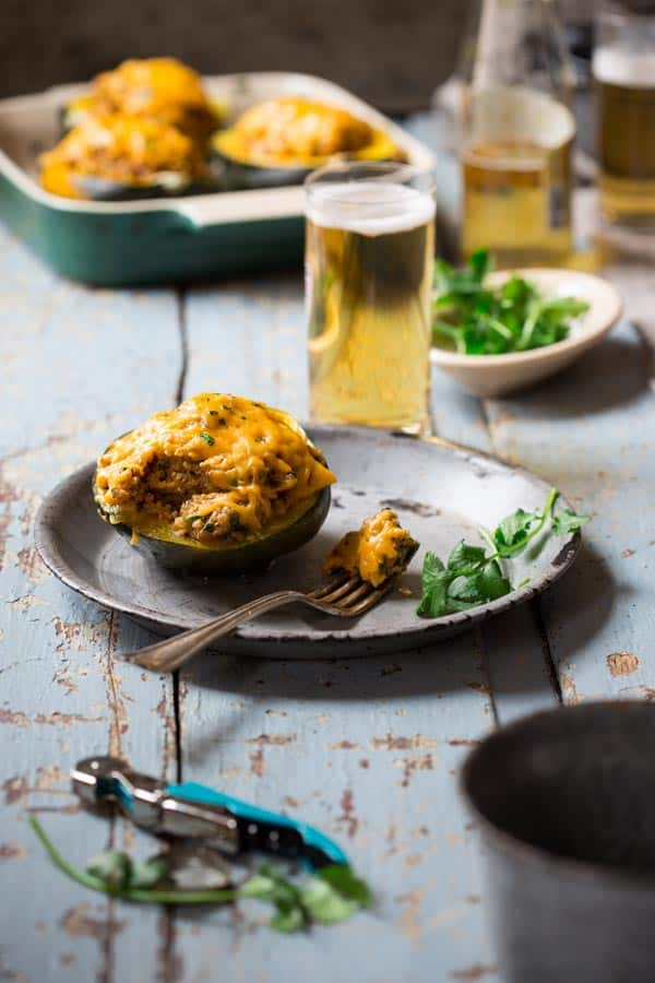 Cheesy Mexican Quinoa Stuffed Acorn Squash, a 30 minute vegetarian, gluten-free weeknight dinner from Healthy Seasonal Recipes by Katie Webster