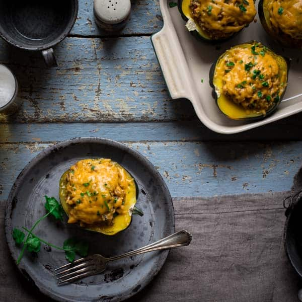 Cheesy Mexican Quinoa Stuffed Acorn Squash on plate with fork